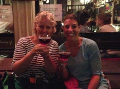 The girls sample a cherry beer.