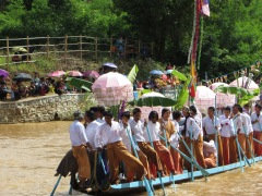 The boats or floats arrive one by one with some great chanting and singing. Notice how the guys paddle with their legs.